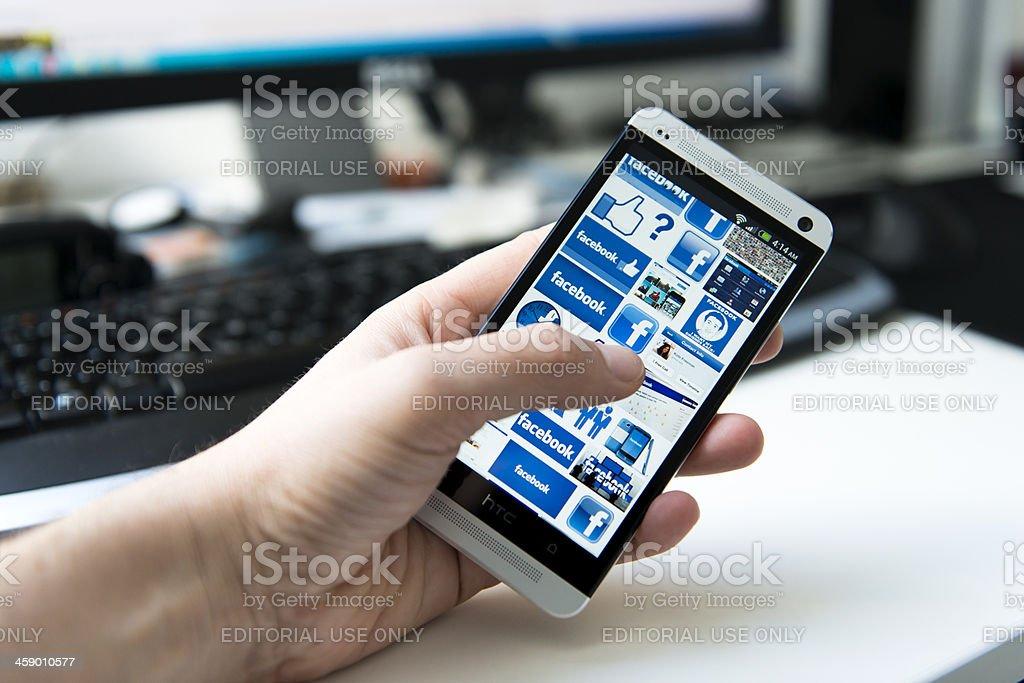 Mobile phone full of logos for Facebook stock photo