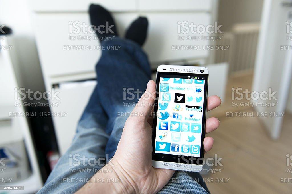 Mobile phone full of logos for Twitter royalty-free stock photo