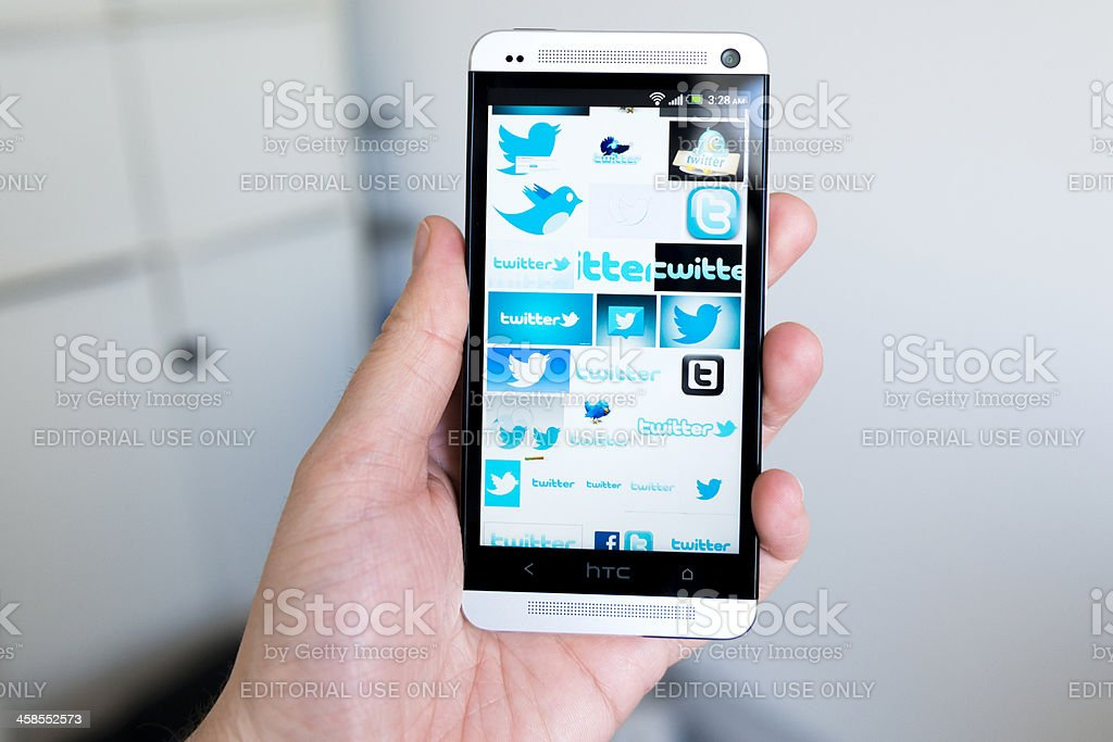Mobile phone full of logos for Twitter royalty-free stock photo