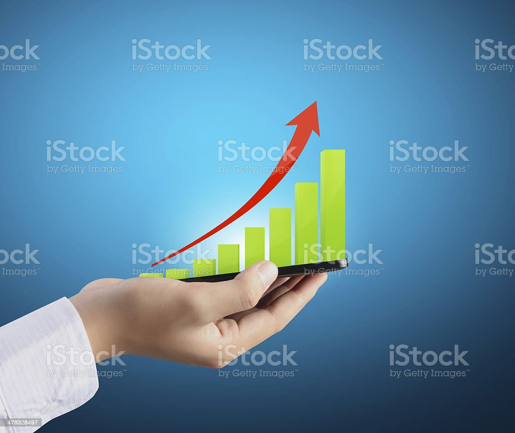 mobile phone in hand and graph royalty-free stock photo