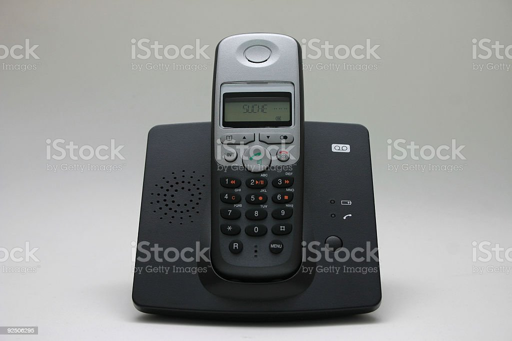 Mobile phone in home station stock photo