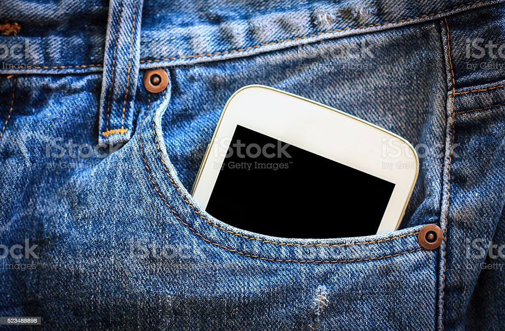mobile phone in jeans pocket with black screen stock photo