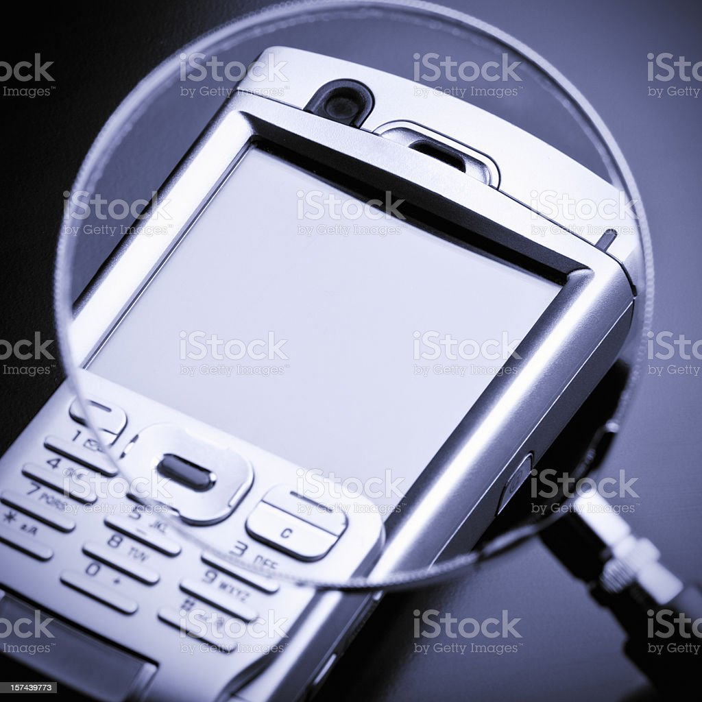 Mobile phone inspection royalty-free stock photo