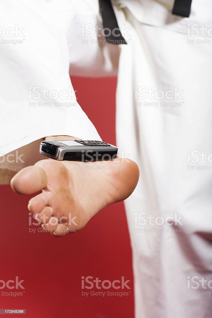 Mobile phone is laying on gilr's foot royalty-free stock photo