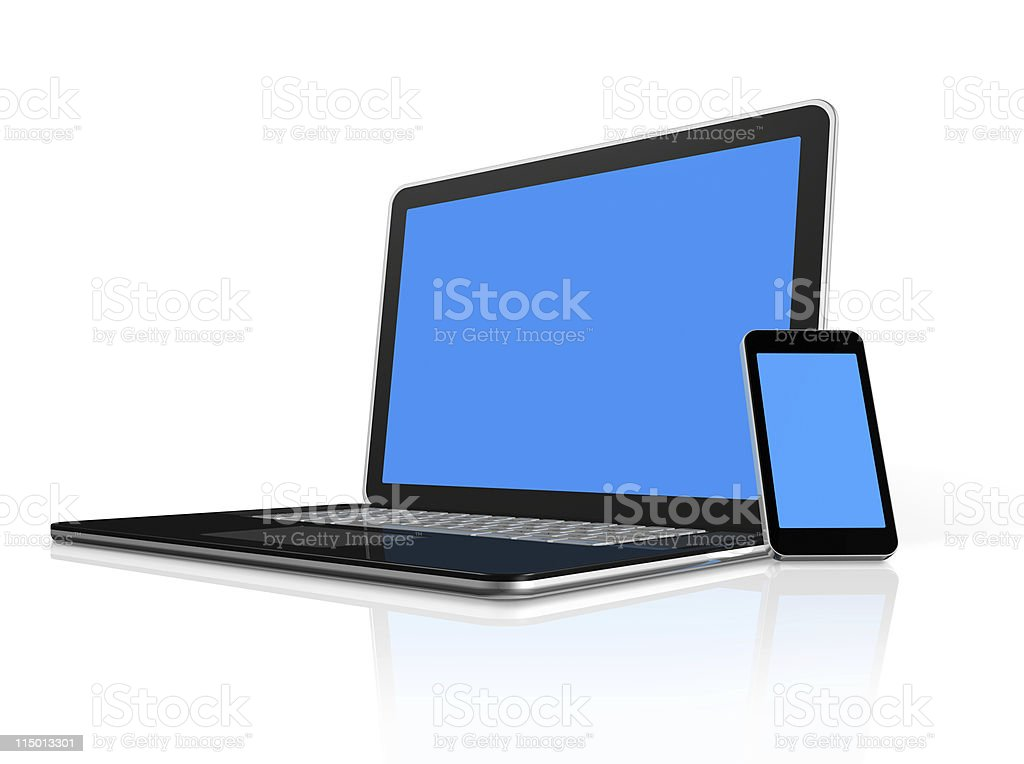 A mobile phone leaning on a laptop stock photo