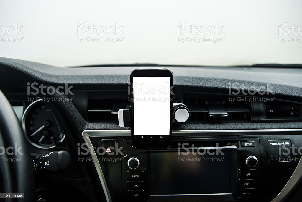 Mobile phone on car with copy space stock photo