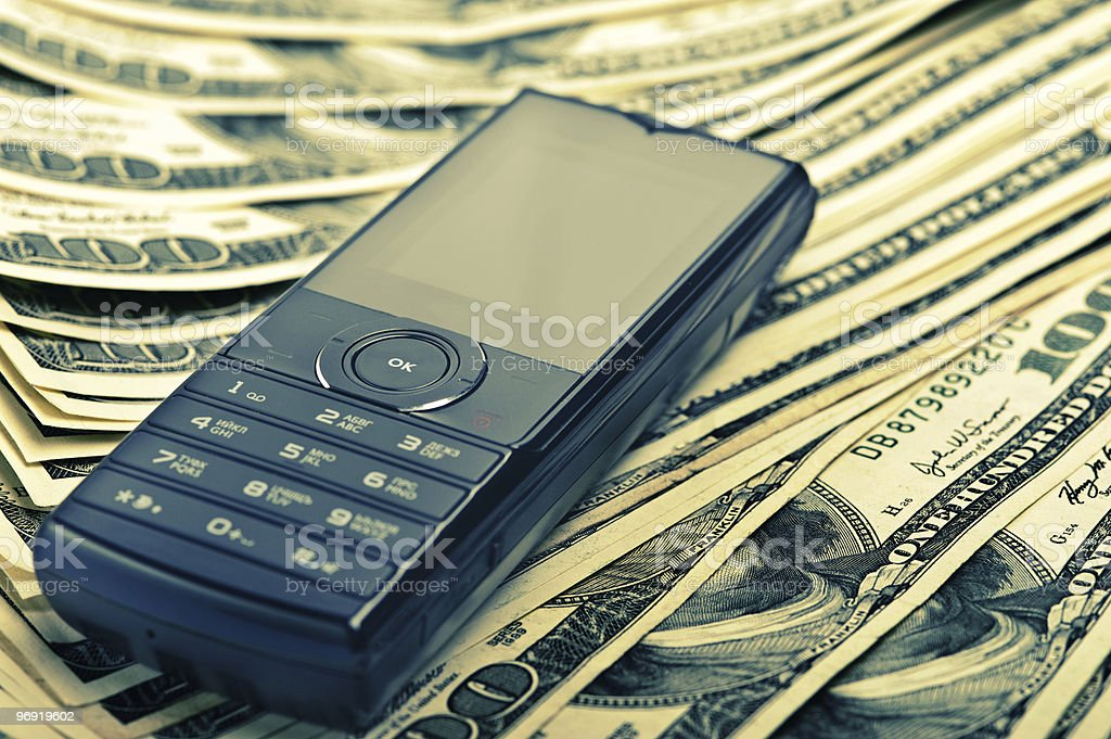 mobile phone on the money royalty-free stock photo