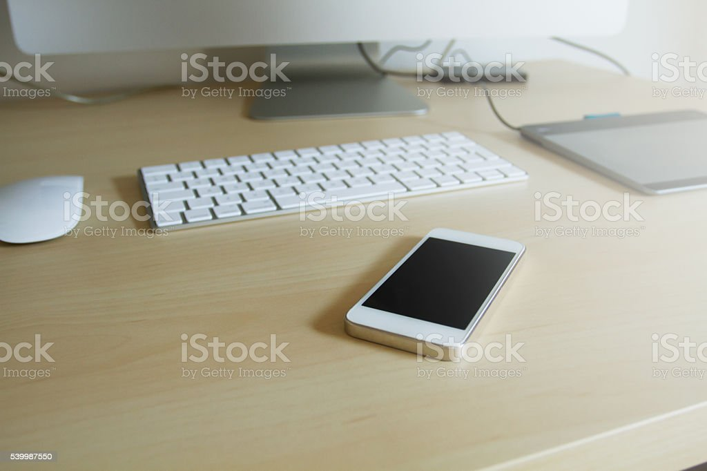Mobile phone on the office table stock photo