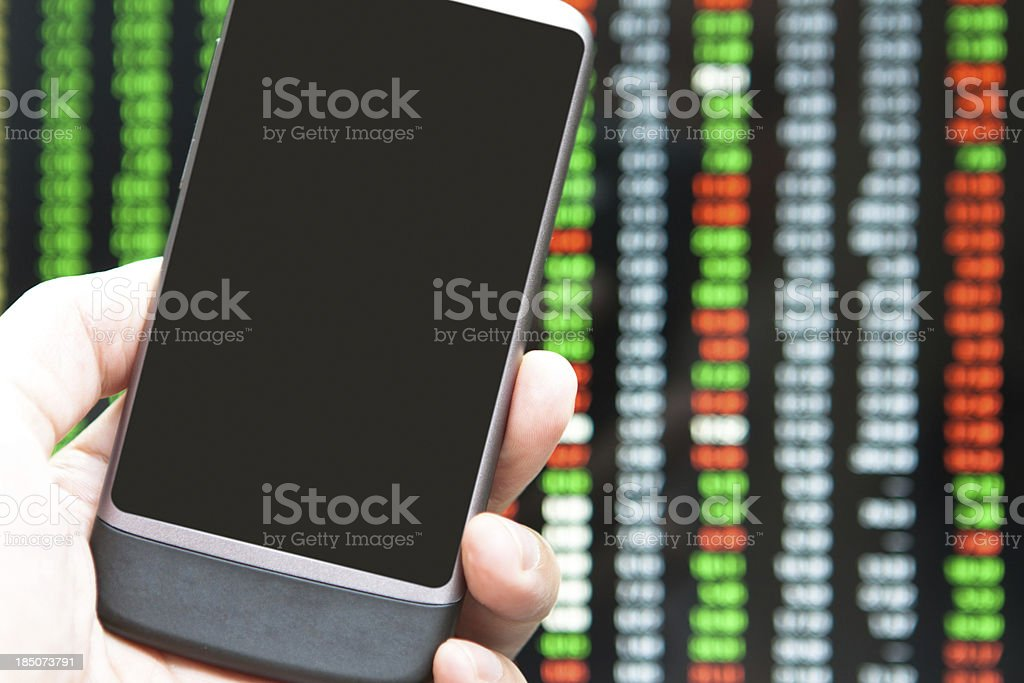 Mobile Phone Over Charts close up stock photo