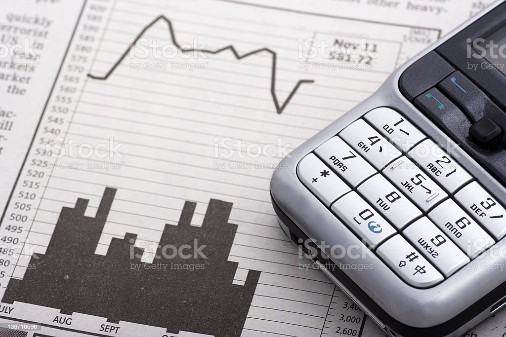 Mobile Phone Over Charts royalty-free stock photo