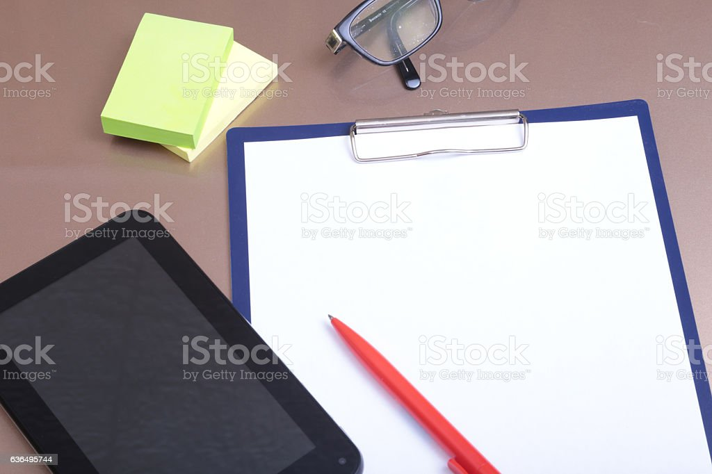 Mobile phone, pen and folder on wooden background stock photo