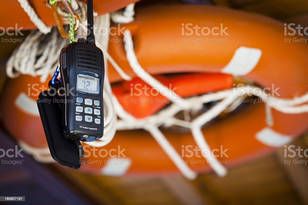 Mobile phone tied with rope to life preserver stock photo