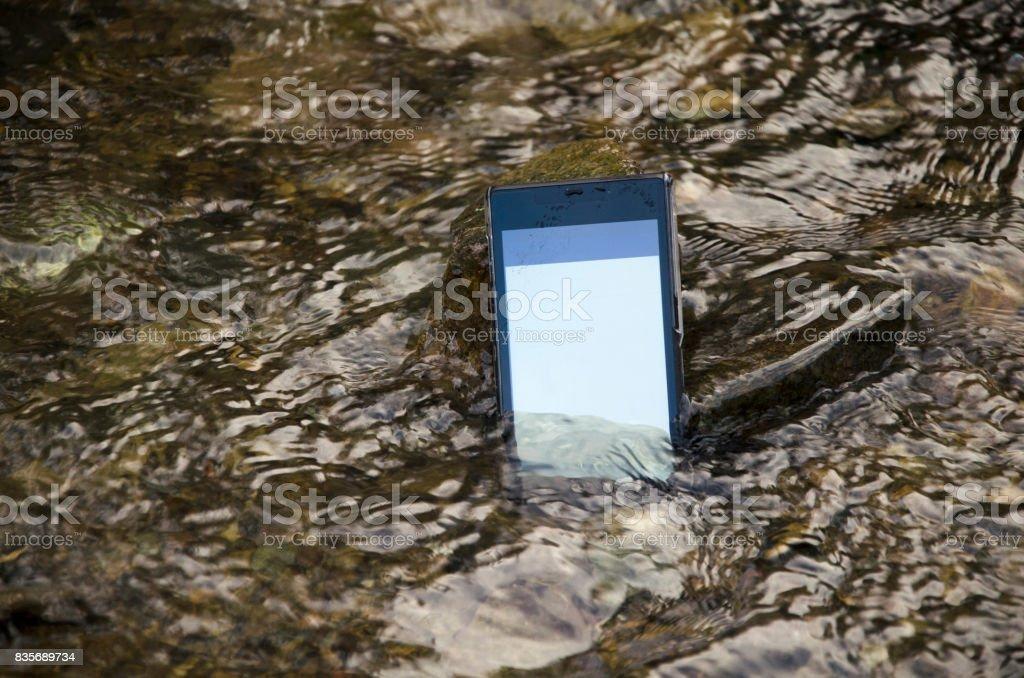 Mobile phone underwater, waterproof. stock photo