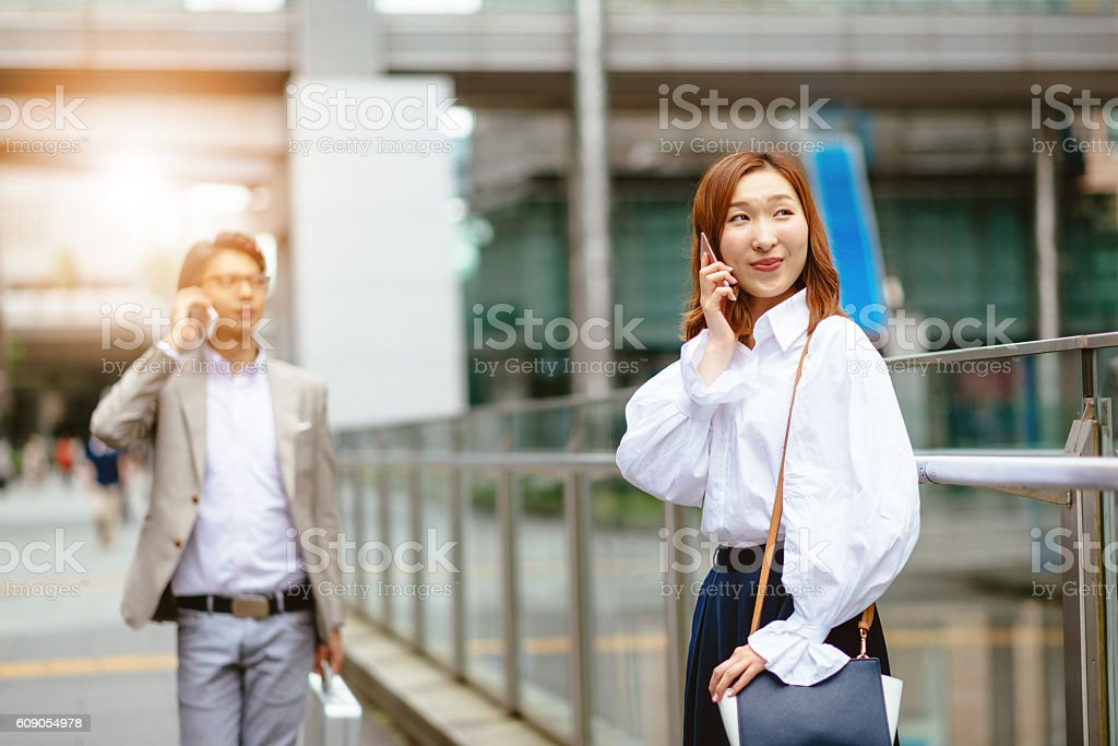 Mobile phone usage in business society stock photo