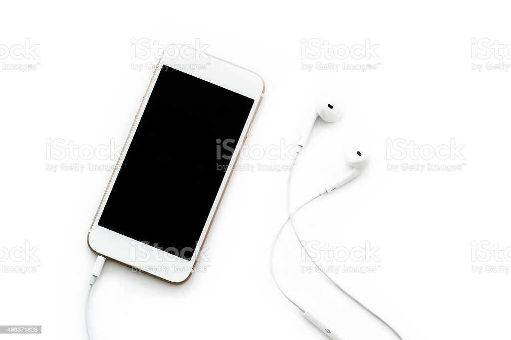 Mobile phone with headphone stock photo
