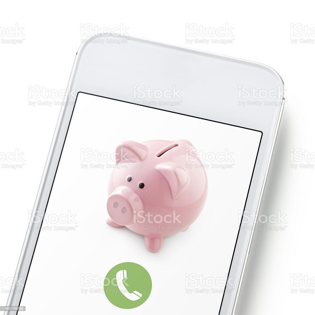 Mobile phone with piggy bank stock photo