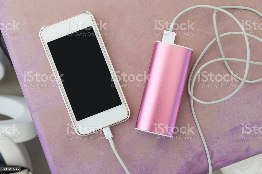 mobile phone with power charger stock photo