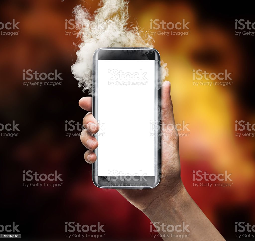 Mobile phone with smoke effect with background stock photo