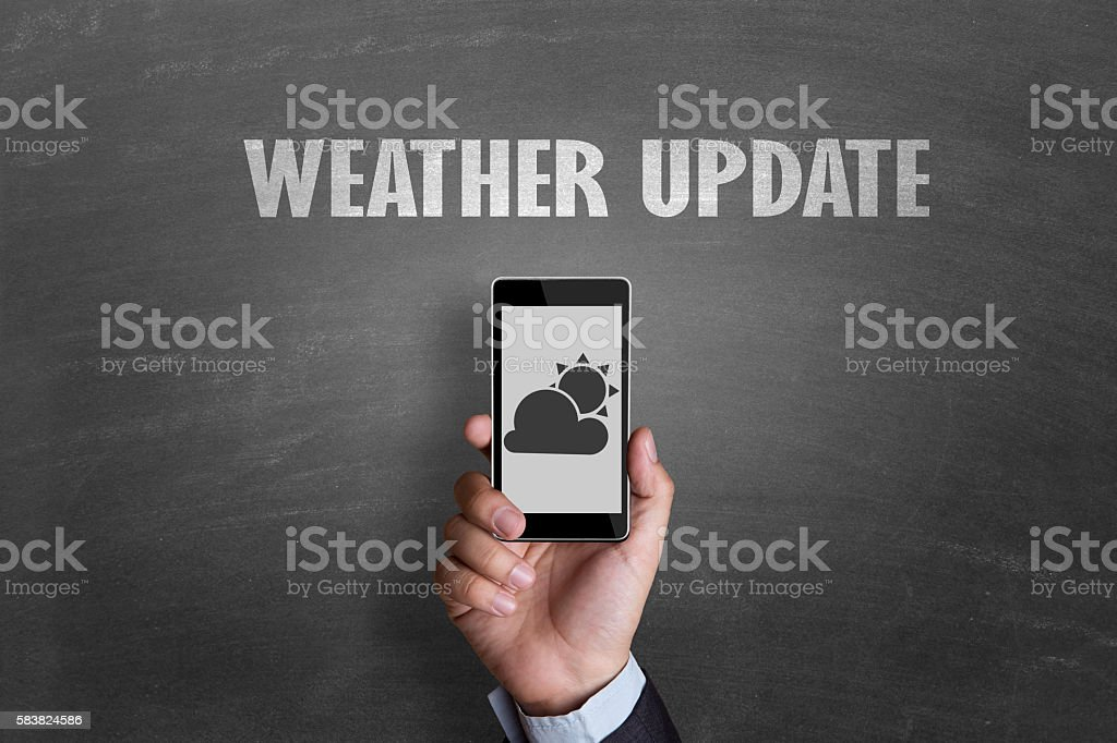 Mobile phone with weather app stock photo