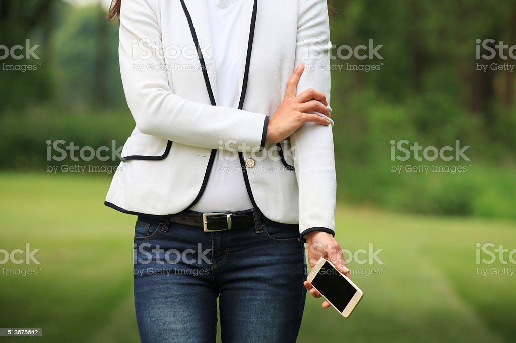 Mobile phone with woman stock photo