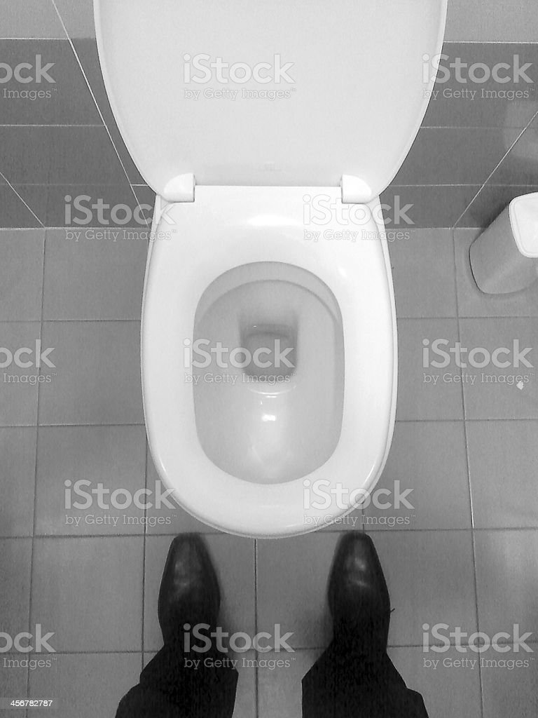 Mobile photo - Man standing on wc stock photo