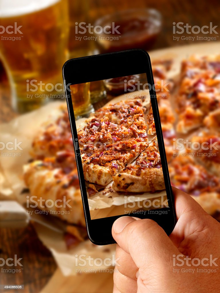 Mobile Photo of Pizza and Beers stock photo