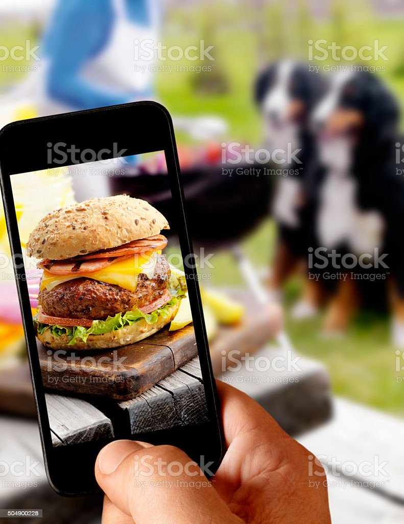 Mobile Photography of a Cheeseburger Outside stock photo