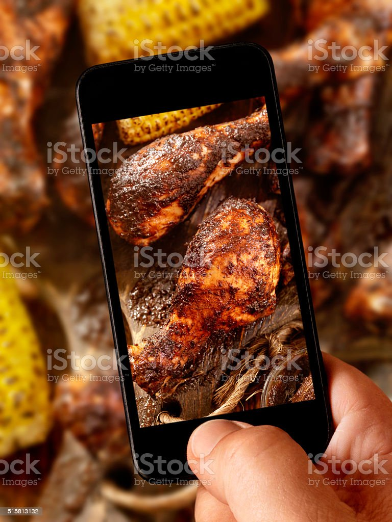 mobile photography of BBQ Grilled Jerk Chicken and Corn stock photo