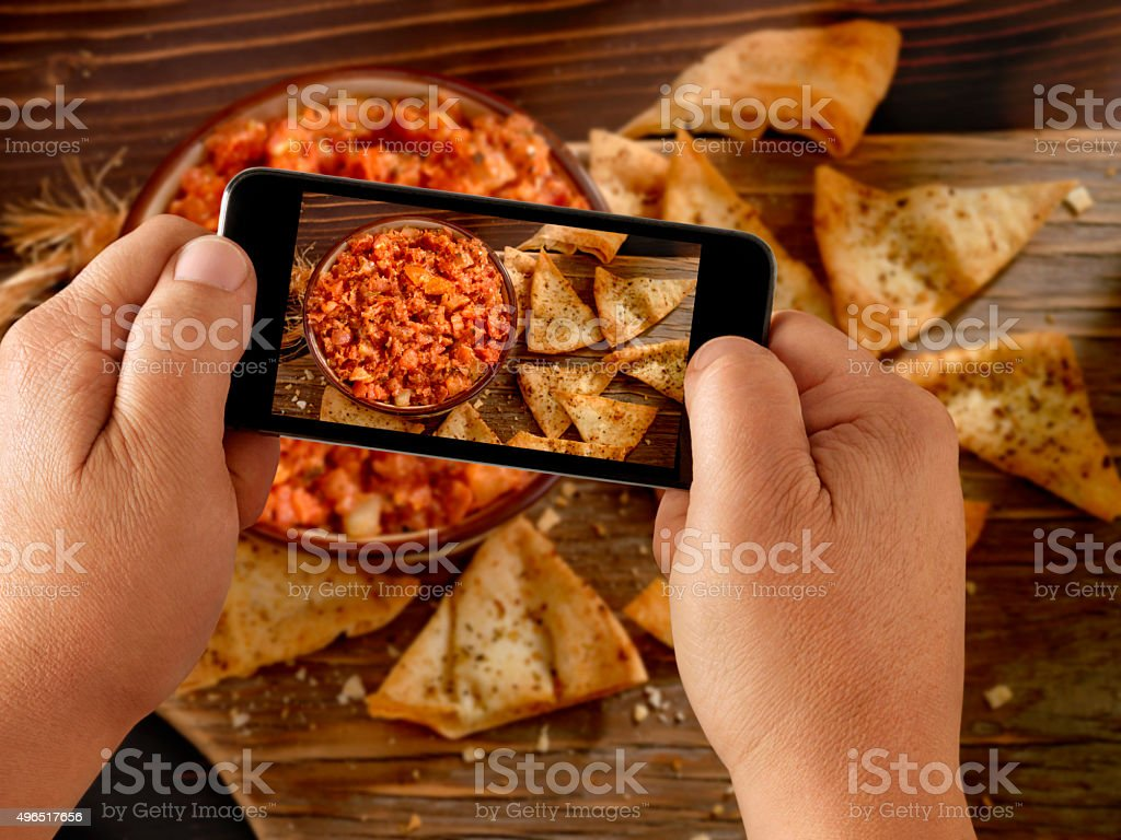 Mobile Photography of Bruschetta with Pita Chips stock photo