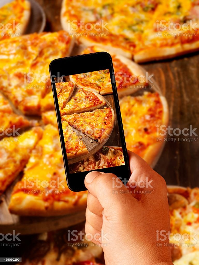 Mobile Photography of Cheeseburger Pizza stock photo