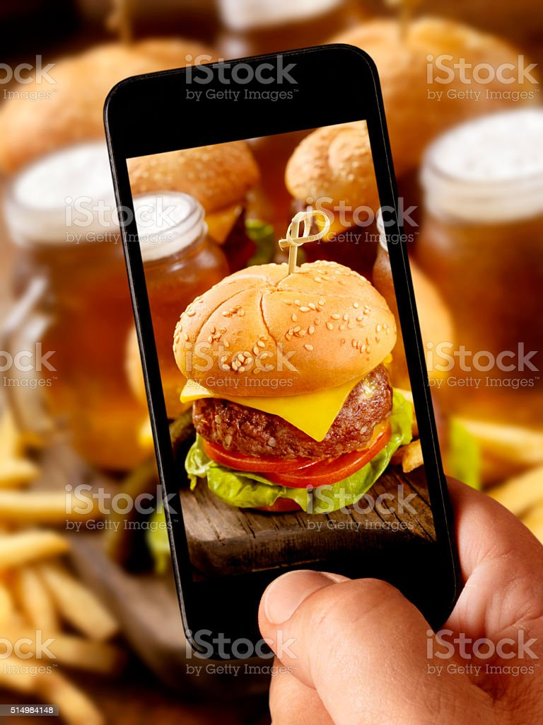 mobile photography of Cheeseburger Sliders with Beer Samplers stock photo