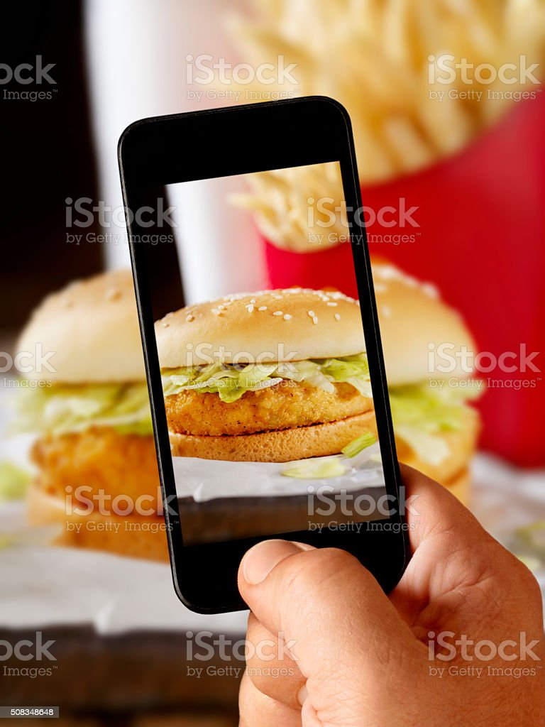 Mobile Photography of Crispy Chicken Burger stock photo