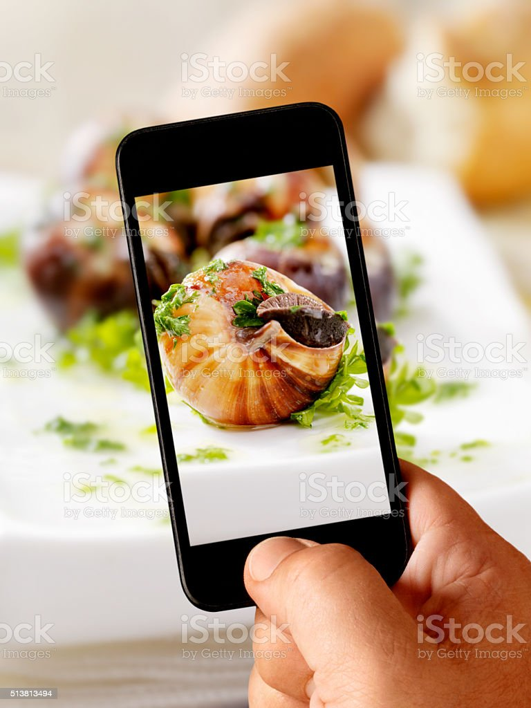 Mobile Photography of Escargot stock photo