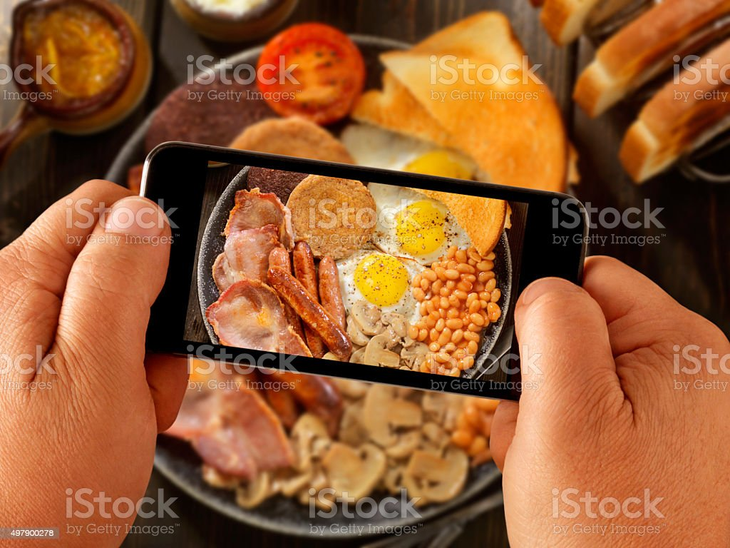 Mobile Photography of Full Traditional English Breakfast stock photo