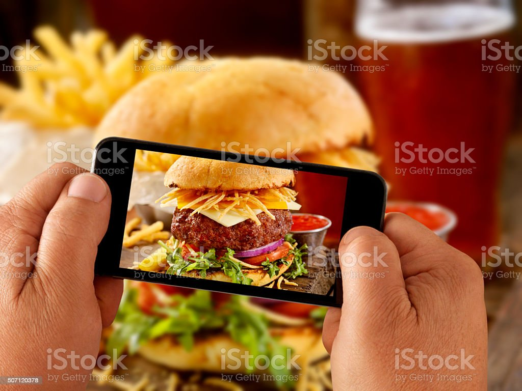 Mobile Photography of Gourmet Burger, Fries and a Beer stock photo
