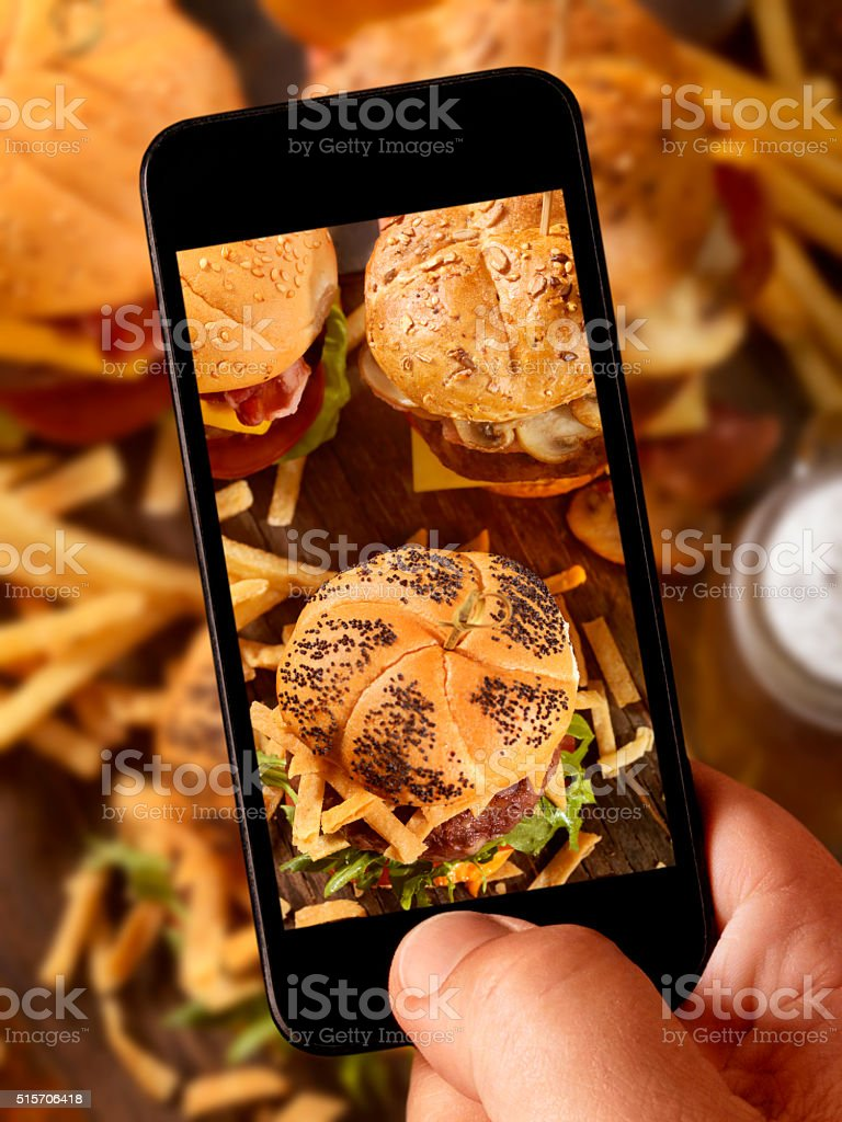 mobile photography of Gourmet Mini Burgers stock photo