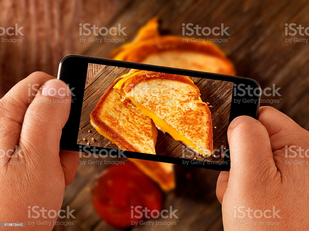 mobile photography of Grilled Cheese Sandwich stock photo
