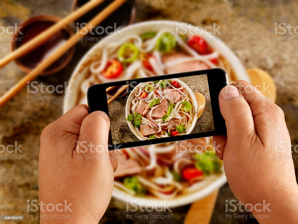 Mobile Photography of Grilled Chicken and Rice noodle soup stock photo