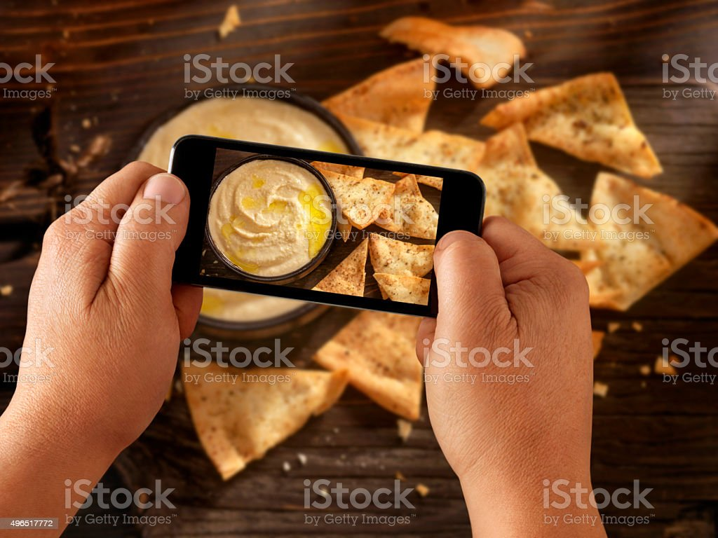 Mobile Photography of Hummus with Pita Chips stock photo
