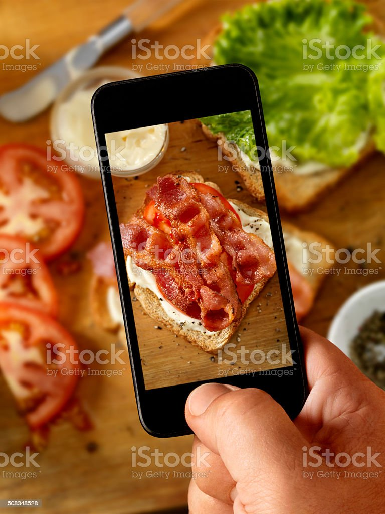 Mobile Photography of Making a BLT Sandwich stock photo
