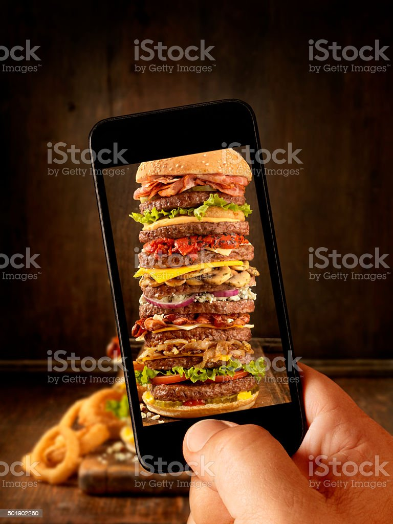 Mobile Photography of Massive Burger stock photo