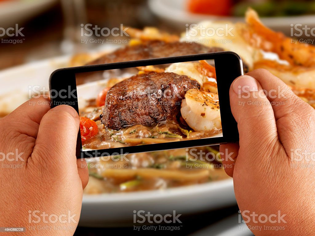 Mobile Photography of Medium Rare Steak Dinner stock photo