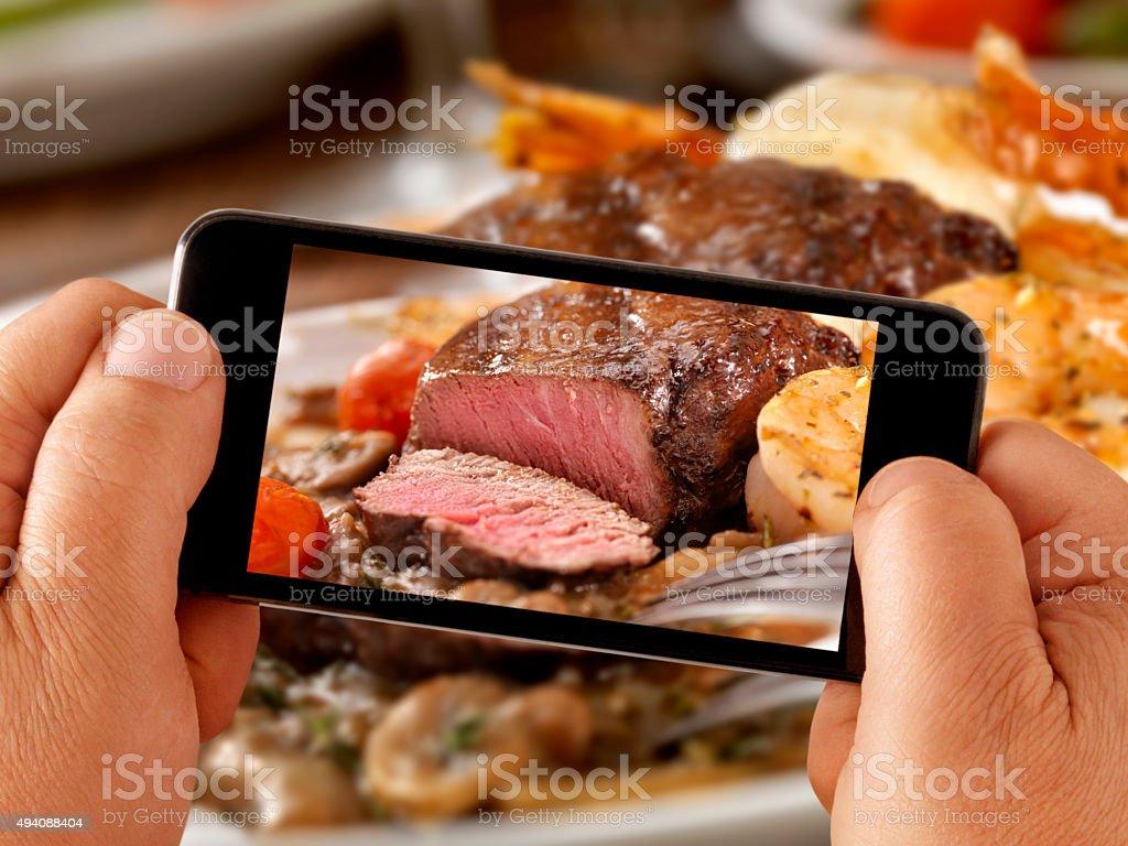 Mobile Photography of Medium Rare Steak Dinner stock photo
