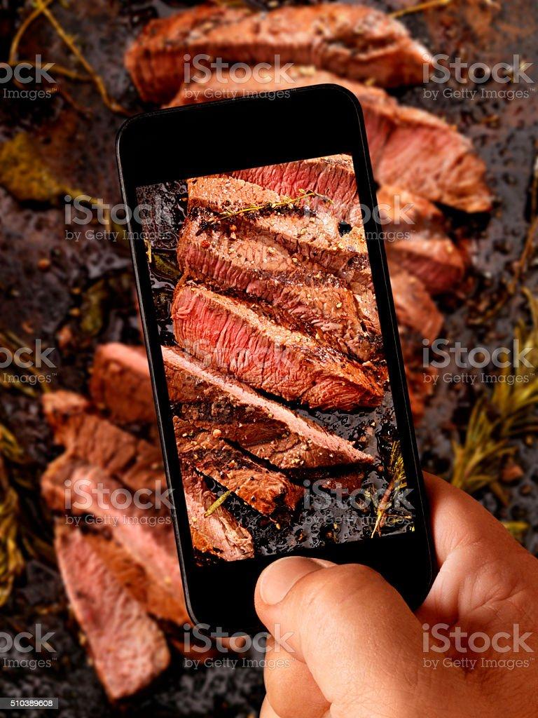 Mobile Photography of Medium Rare Steak stock photo
