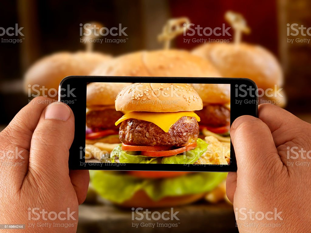 mobile photography of Mini CheeseBurgers with Fries stock photo