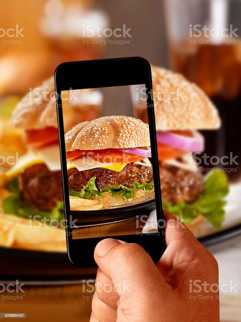 Mobile Photography of my Deluxe CheeseBurger stock photo