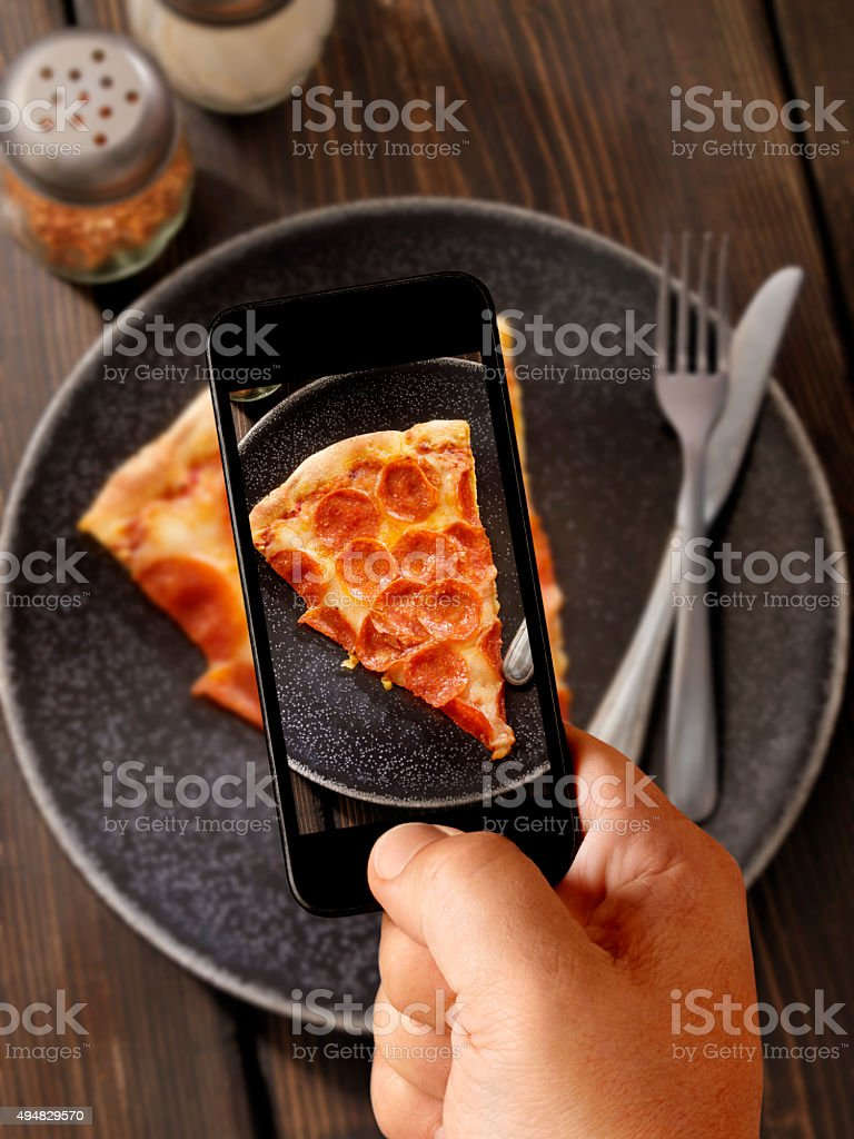 Mobile Photography of Pepperoni Pizza stock photo