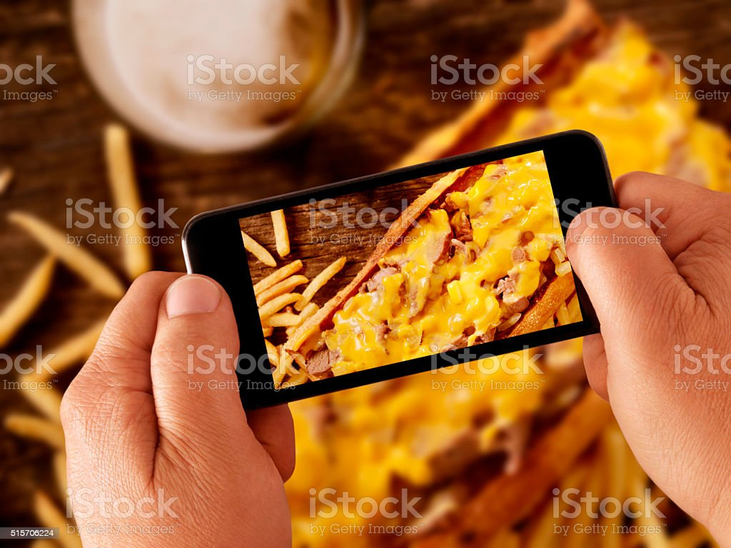 mobile photography of Philly Cheese Steak Sandwich stock photo