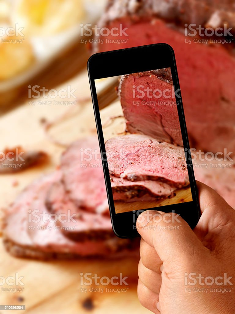 Mobile Photography of Prime Rib Roast Beef stock photo
