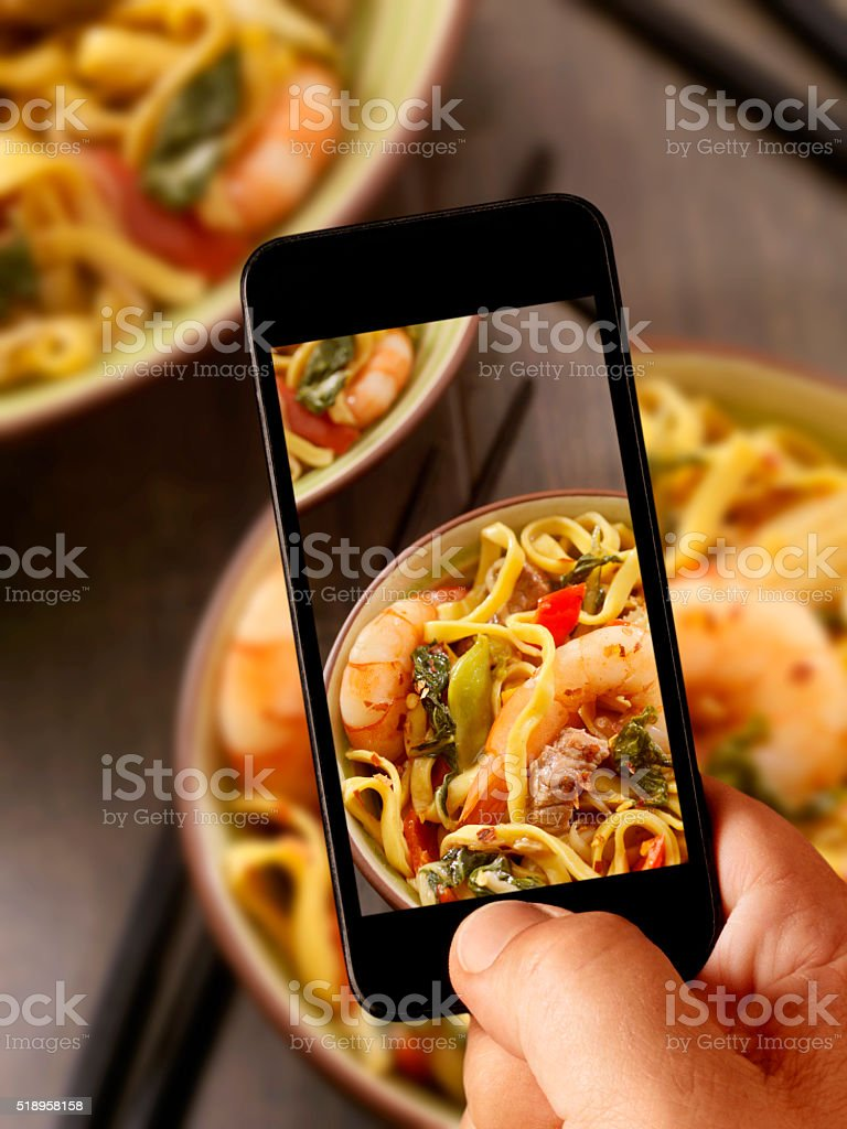 mobile photography of Shrimp and Beef Stir Fry with Noodles stock photo